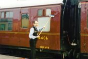 The guard cleaning carriages. (C) Dave Outibridge