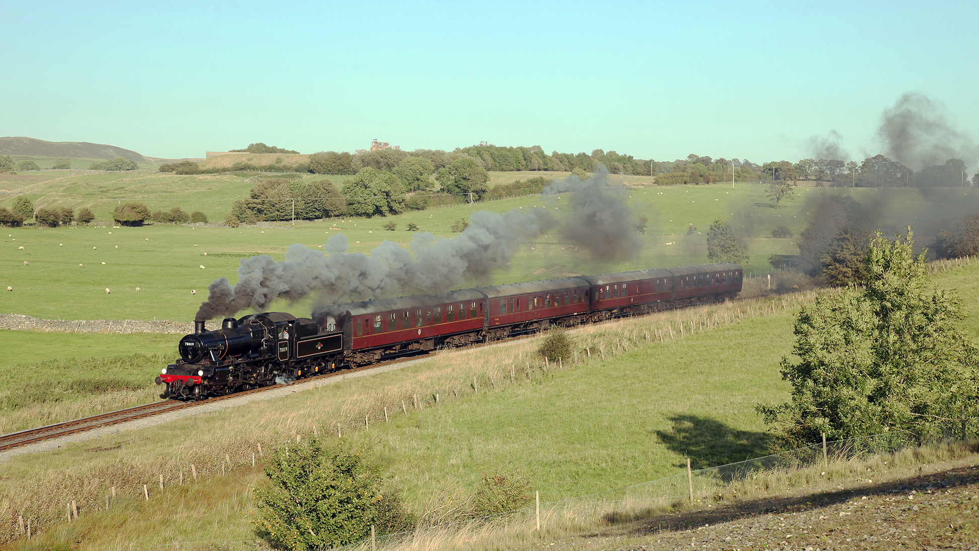 You'll journey in our historic Mark 1 carriages.  Here BR 2-6-0 No.78019 west of Holywell with a train from Bolton Abbey to Embsay, 26th September 2009
