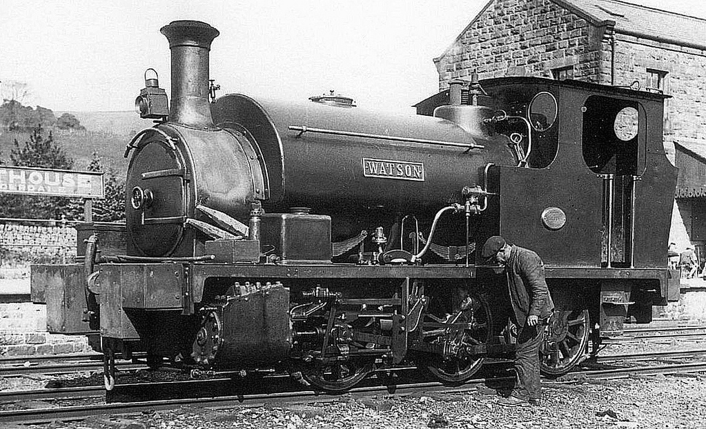 Sister loco Hudswell Clarke 0-6-0ST 'Watson' is oiled by her driver at Lofthouse station on the Nidd Valley Light Railway. The picture, photographer unknown, was taken in 1928, a year before passenger services ceased.